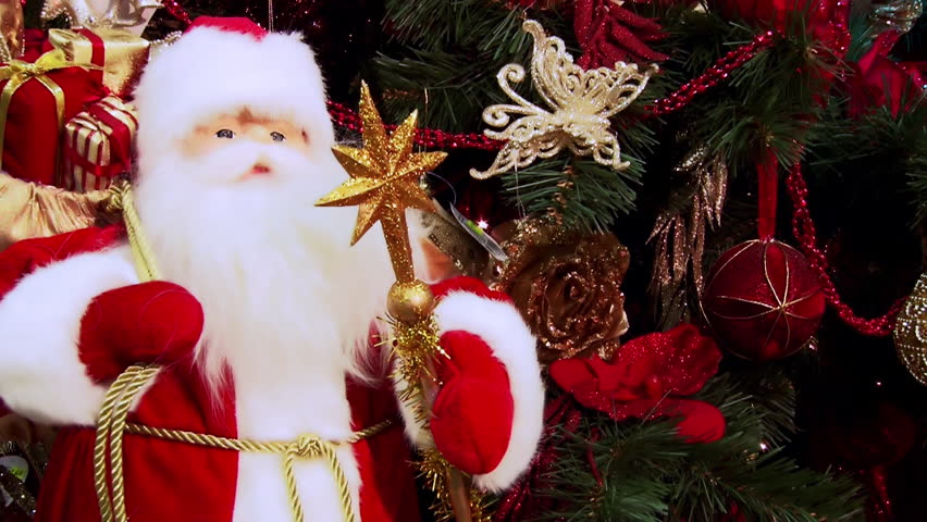 Christmas screen savers. New Year's toys on the Christmas tree. Glittering lights. Santa Claus under the Christmas tree. Glittering lights.   Shutterstock HD Video #12200267