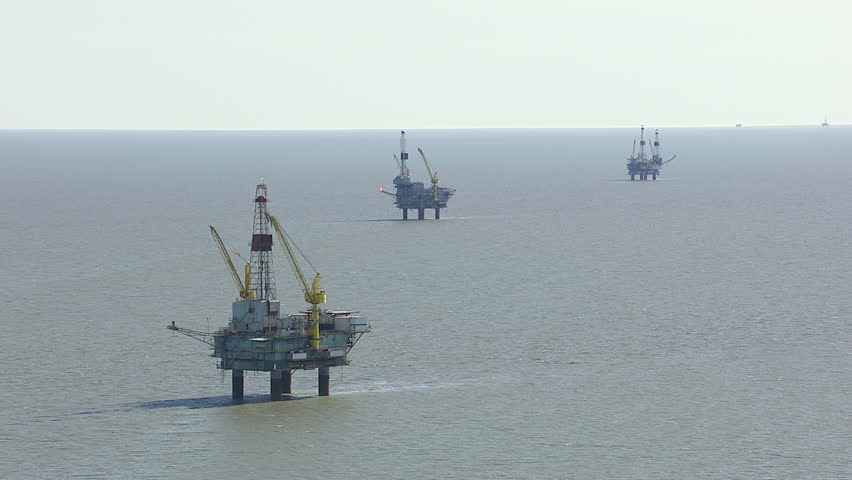 MS AERIAL DS Shot of natural gas rigs in sea / Alaska, United States
