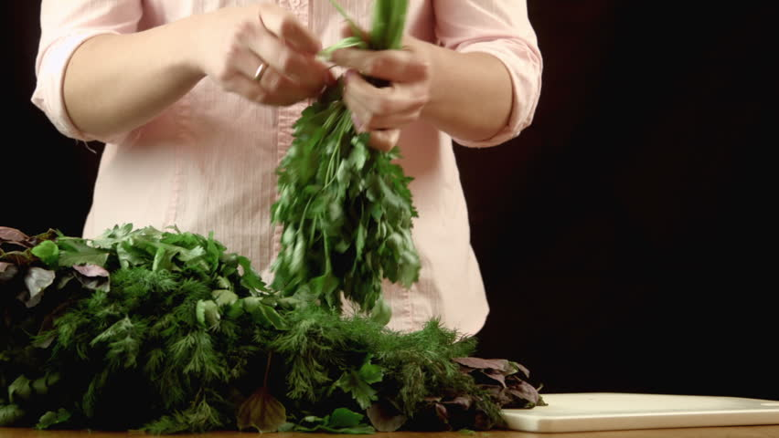 The girl sorts parsley fennel and a basil, and puts them in bunches | Shutterstock HD Video #12240038