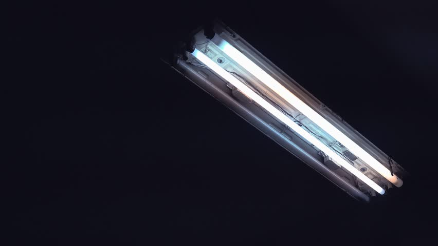 Neon fluorescent lighting, neon light glass tubes switching on and off, 4k 2160p uhd footage.