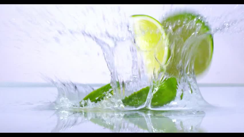 Lime splashing into water in slow motion #12269078