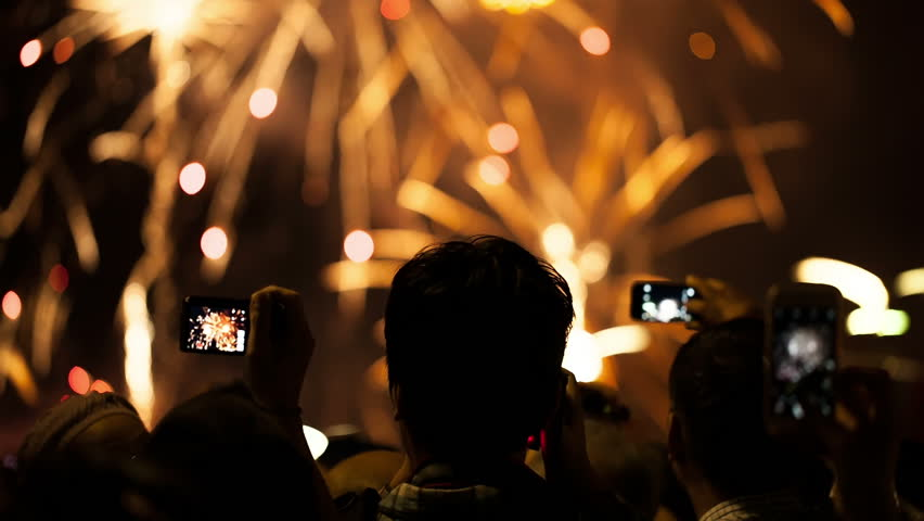 Watching Fireworks silhouetted crowd. Holiday backgrounds. Fireworks in the sky celebrating lunar new year... >>> Please search more:
