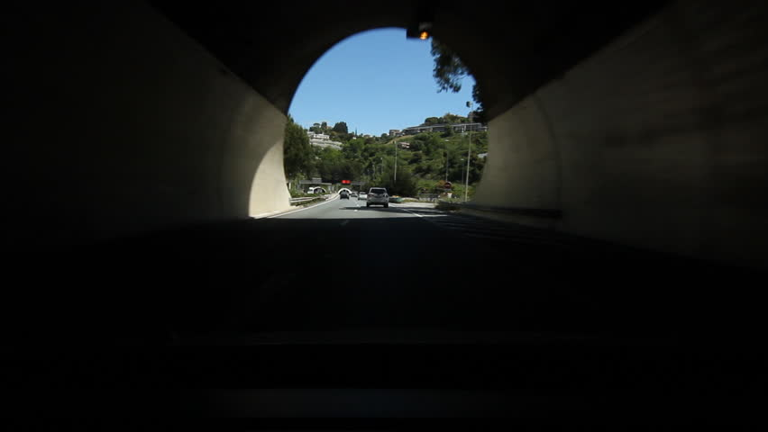 Driving from tunnel to tunnel on the A8 autoroute, also known as La Provençale, is a 224-kilometer (139 mi) long highway in France. Nice, South of France.