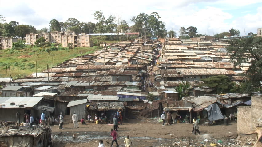 Busy Street and view over rooftops in African slum