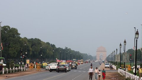Time lapse shot of traffic on city road, India Gate, New Delhi, India