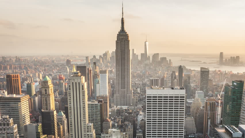 NEW YORK CITY - April 14, 2014: Aerial view of Manhattan skyline during dusk. Locked. Sunset. Vintage. Time lapsed view of the famous New York buildings.
