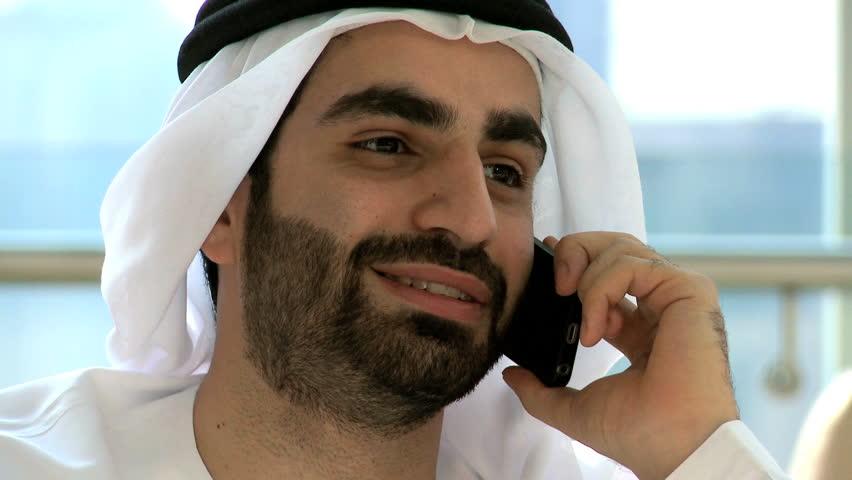Emirati Arab male kandura business insurance trade growth smart phone technology | Shutterstock HD Video #12326897