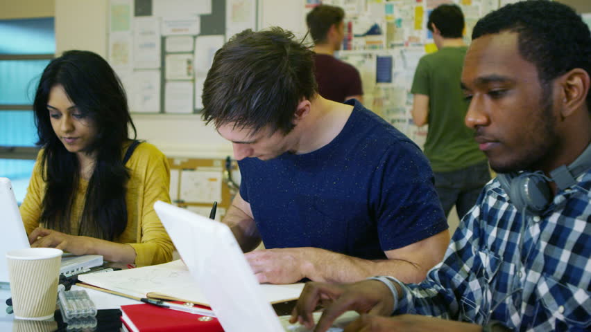 4K Portrait of smiling male student working in class with other students. Shot on RED Epic. #12342257