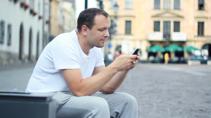 Man sending sms message in the city | Shutterstock HD Video #1234807