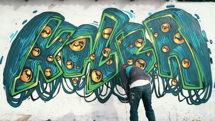 Graffiti artist drawing on the wall, time lapse