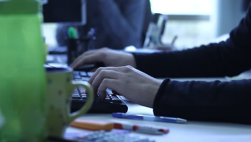 Worker typing in the office during working time. | Shutterstock HD Video #12374747