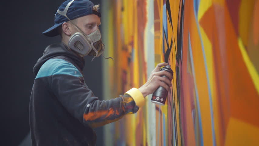 Graffiti Artist Painting On The Wall, Interior