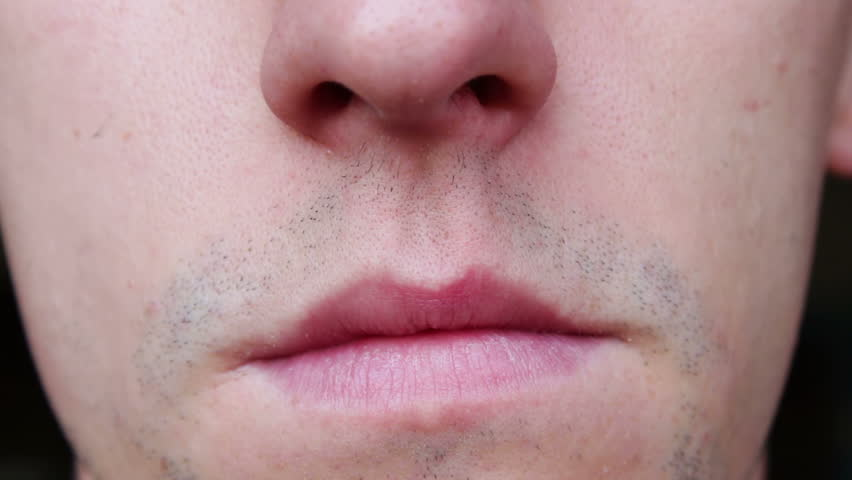 Young Man dripping nose drops.   Shutterstock HD Video #12382217