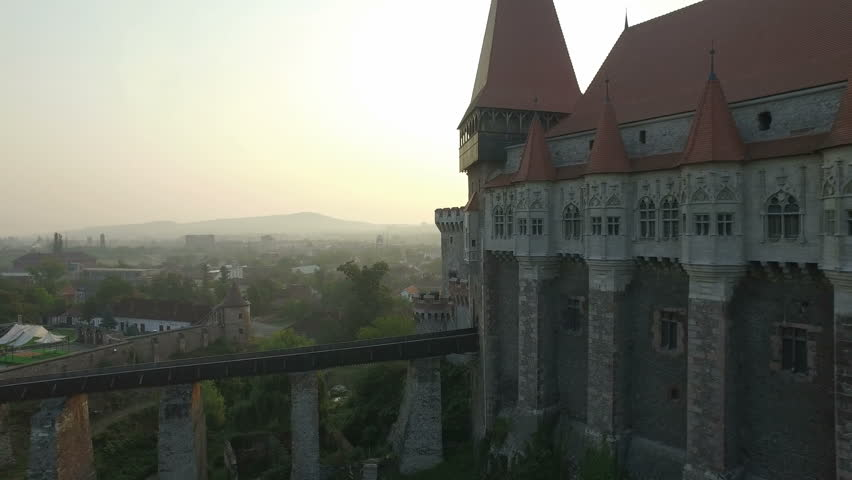 4K aerial shot of the Corvin Castle at dawn – a Gothic-Renaissance castle in Romania and one of the largest castles in Europe