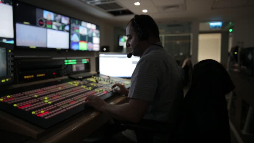 Director broadcast video mixer operation - track left | Shutterstock HD Video #12410237