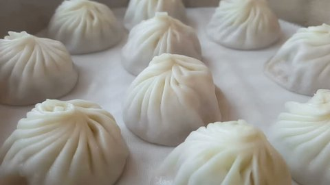 Hot Xiaolongbao soup dumplings with steam. (Traditional Chinese food)