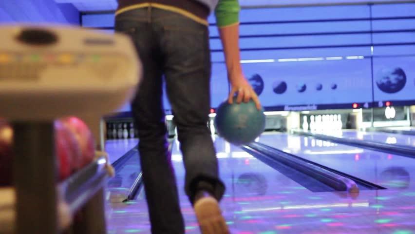 man plays bowling - Strike