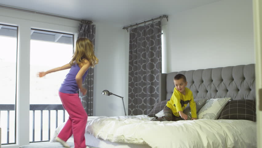 Brother and sister share a hotel room