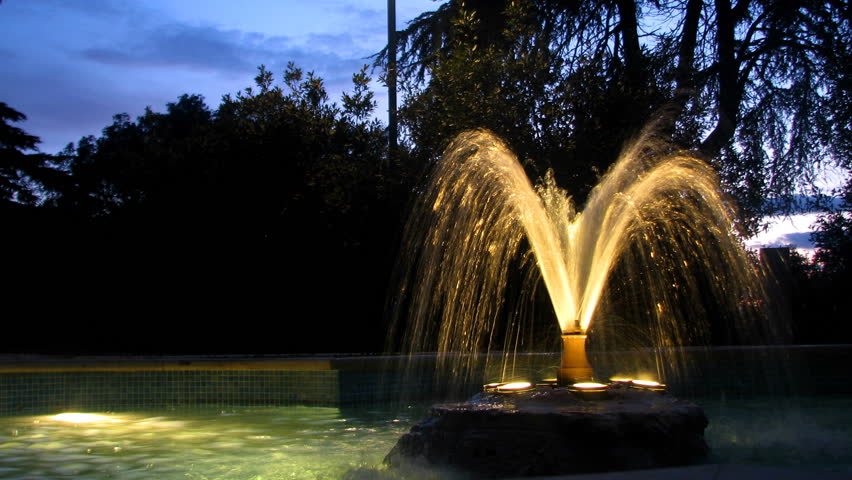 Illuminated fountain in the park,during the dusk.   Shutterstock HD Video #1246087