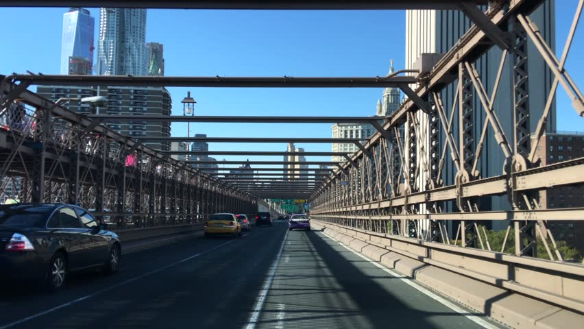 Crossing the Brooklyn Bridge by car. Hi res 4K | Shutterstock HD Video #12469967