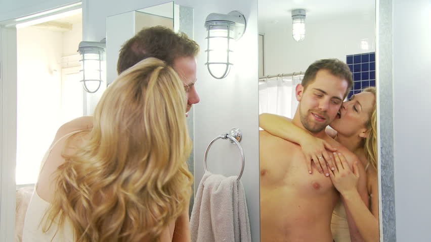 young couple being playful and romantic in bathroom hd stock video clip