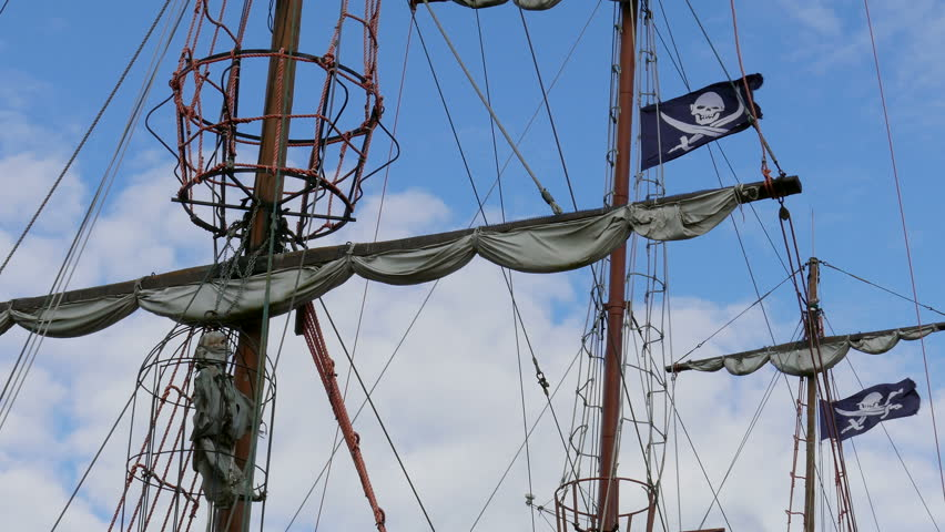 Pirate ship, pirate flag and skeleton in the cage