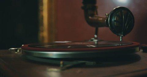 Old gramophone playing vinyl disc closeup.