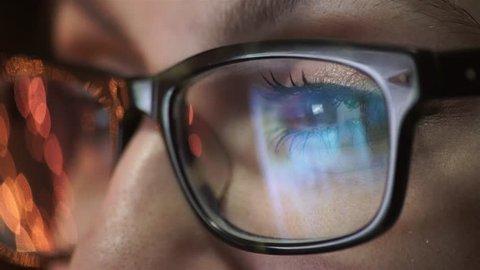 woman eye looking monitor, surfing Internet
