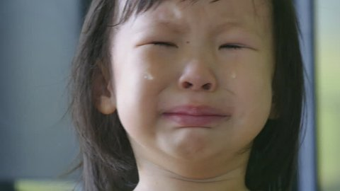 Little Asian girl crying