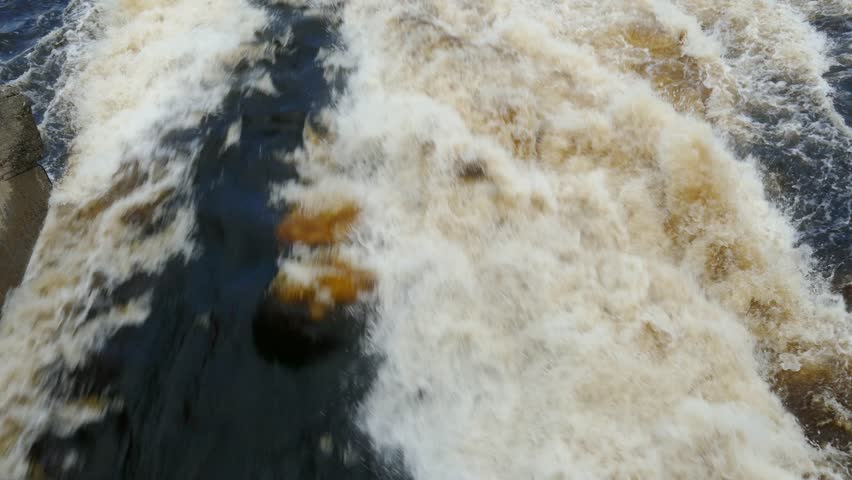 very rapid stream of water escaping from the dam, 4k #12595997