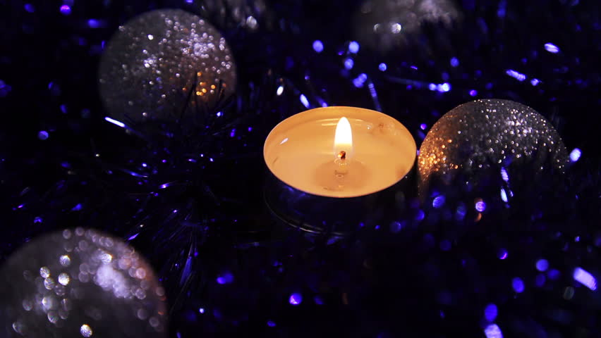 Christmas New Year one candle dark Background, Close-Up . Christmas and New Year