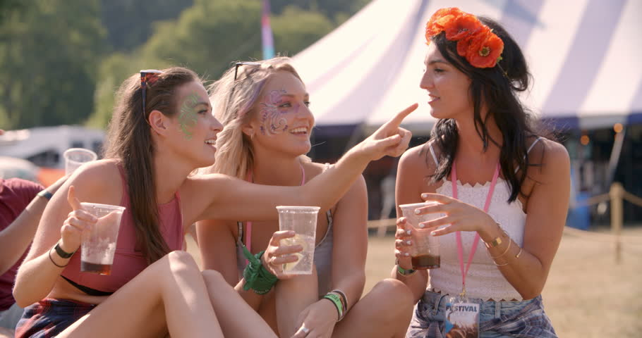 Dinner Party Video Part - 30: Three Female Friends Sitting On Grass At A Music Festival - 4K Stock  Footage Clip