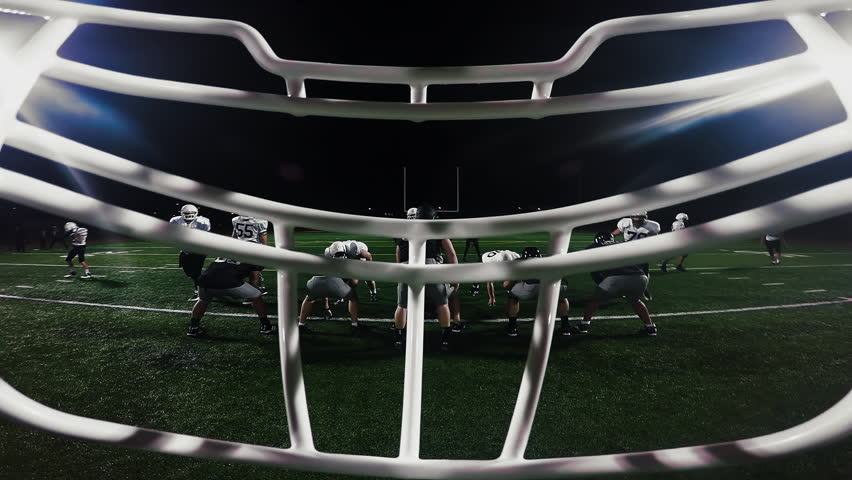 First person point of view from inside a football player's helmet, from the huddle to running a touchdown | Shutterstock HD Video #12617492