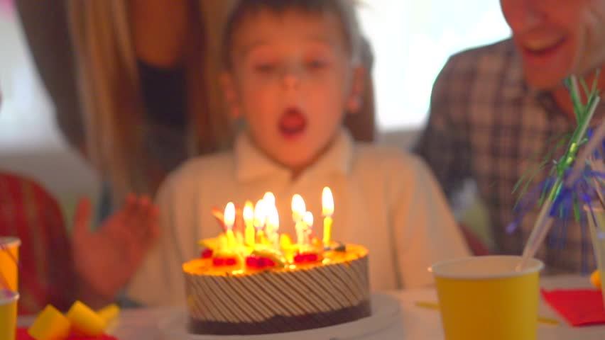 Little Boy Blows Out Candles On Birthday Cake At Party Happy Big Family Celebrating Of Kid Slow Motion 240 Fps High Speed Camera HD 1080p