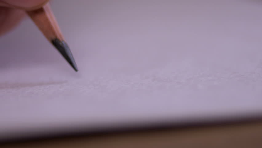 Artists hands drawing wooden pencil writes on paper shot on Red Epic 4K