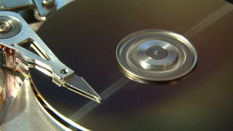 Hard Disk Drive, computer data storage, gold surface.