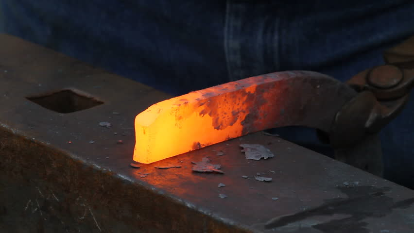 Blacksmith shaping a horseshoe