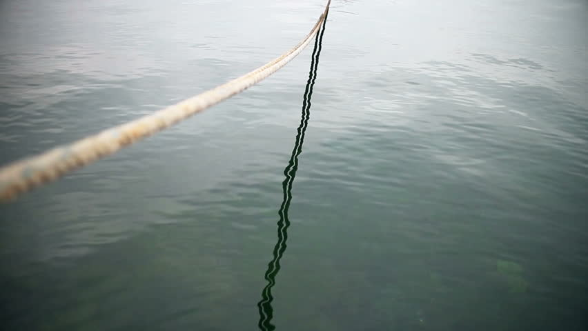 Boat mooring rope in the sea | Shutterstock HD Video #12702077