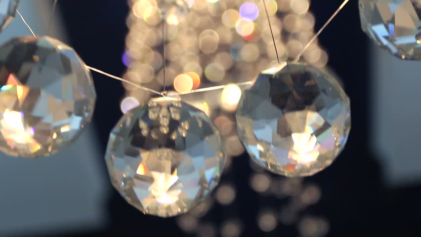 Glass faceted ball, holiday ball, video background with ball, Christmas decoration, game light, abstract glass, polished faces, luxury interior, light and ...