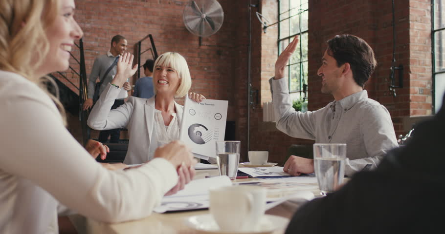 Multi-ethnic business team meeting involved diverse people participating in creative sustainable ideas steadicam shot across boardroom table shared work space high five success | Shutterstock HD Video #12720485