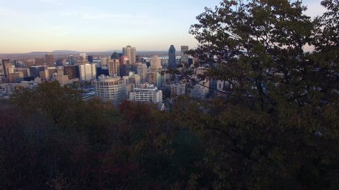 4K aerial drone shot of montreal skyline at sunet up move