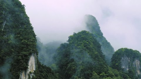 Fog and mist cover limestone mountains picks in Asia. Beautiful nature of Khao Lak national park in Phang Nga Thailand