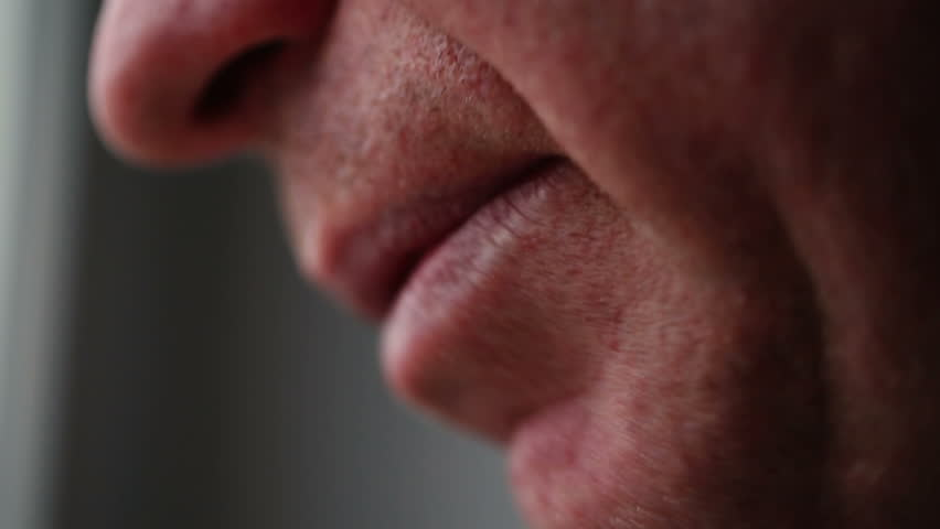 Man of average years mouth talking close up.
