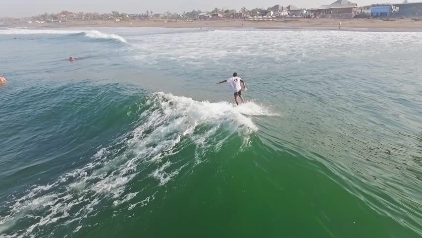 Aerial of a surfer on a mellow wave. Slow motion shot. | Shutterstock HD Video #12771377