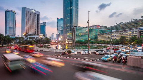 JAKARTA, NOV 14, 2015: Modern office buildings captured at night on Nov 14, 2015 in Jakarta. With over 10 million people, Jakarta is the top emerging cities in ASEAN in term of economic development