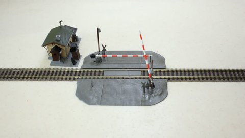 Construction on the railroad crossing, the car crosses it, passing locomotive. Stop motion.
