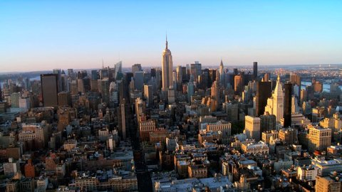 Skyline Helicopter Aerial view of Downtown Manhattan New York City at Sunset, North America USA