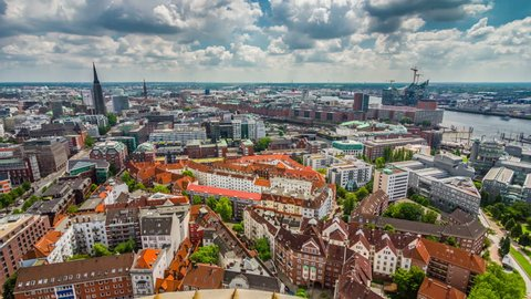 Aerial view of Hamburg city and Hamburg port with cloudy sky at day. 4K Timelapse view.