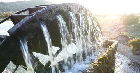 a water wheel to lift water for irrigation of grape fields in Bosnia