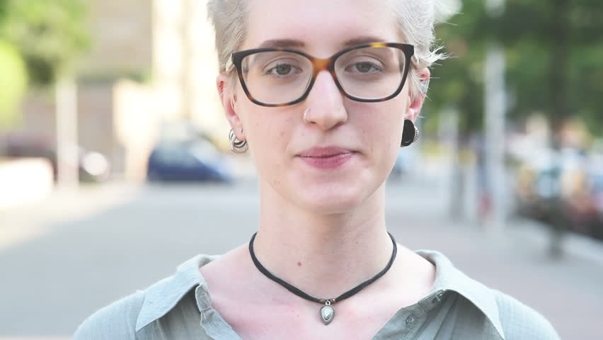 Video portrait of young handsome caucasian blonde hair designer woman looking in camera, wearing glasses, pensive – thoughtful, seriousness, thinking future concept | Shutterstock HD Video #12817109